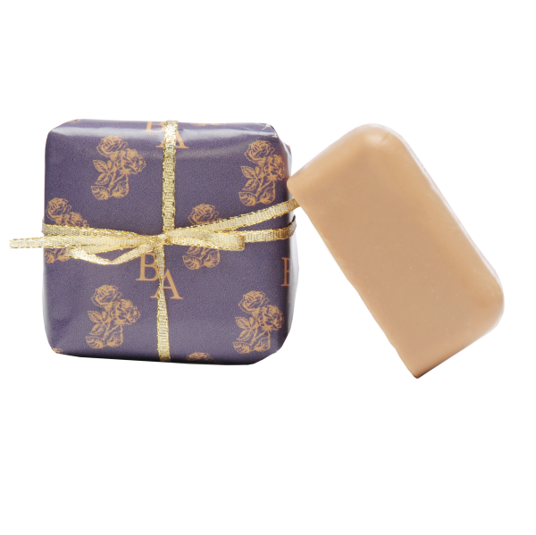 Two bars of soap one wrapped as a gift, essential oil soap