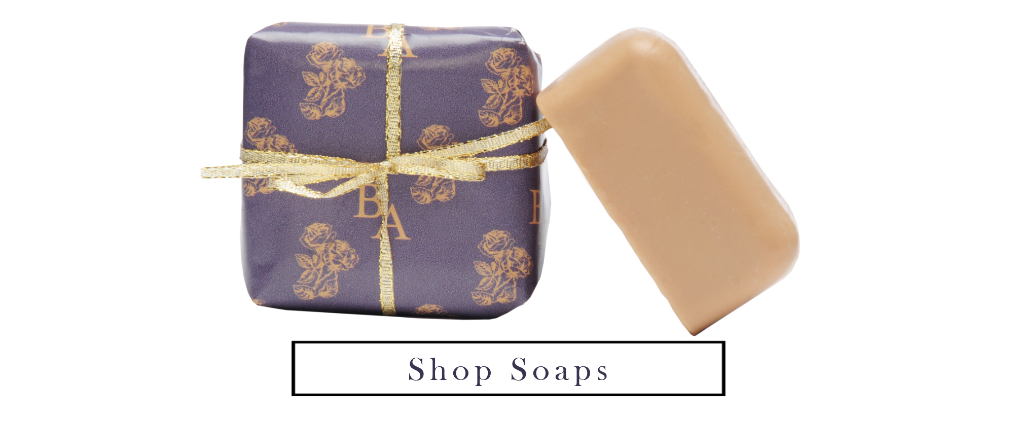 Two bars of Essential oil soap one wrapped in purple and gold/